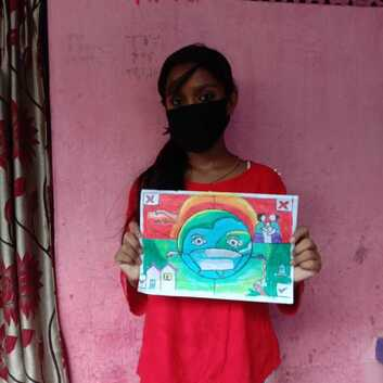 A child in India holding her entry for the drawing competition