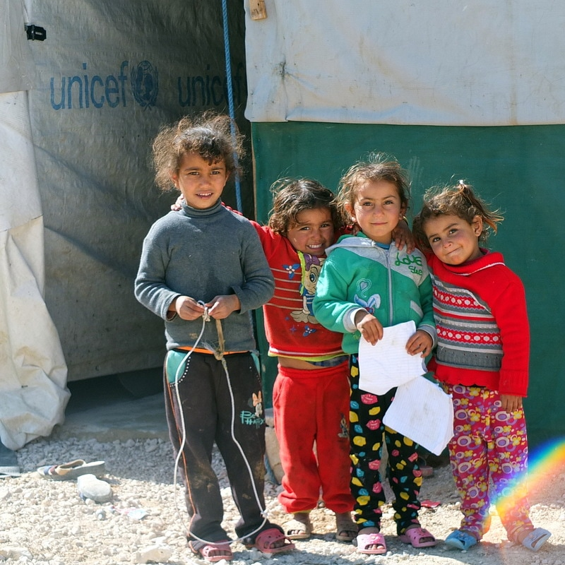 Syrian refugee children outside a tent school in Bekaa Valley, Lebanon